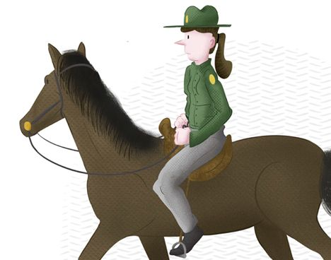 female park ranger riding a brown horse